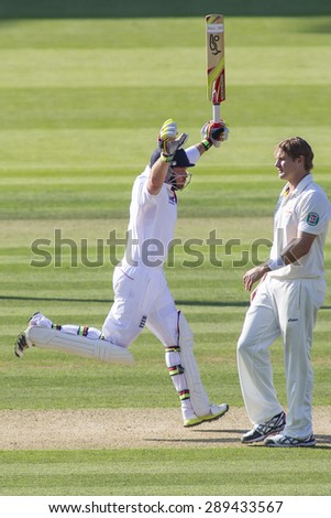 LONDON, ENGLAND - July 18 2013: Ian Bell celebrates a century past Shane Watson on day one of the Investec Ashes 2nd test match, at Lords Cricket Ground on July 18, 2013 in London, England.