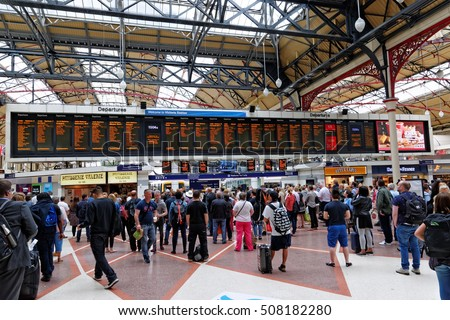 LONDON, ENGLAND - JULY 8, 2016: Inside view of Victoria Station departure terminals. Build in 1860 is the second busiest railway terminal after Waterloo, also serving trains to Gatwick Airport.