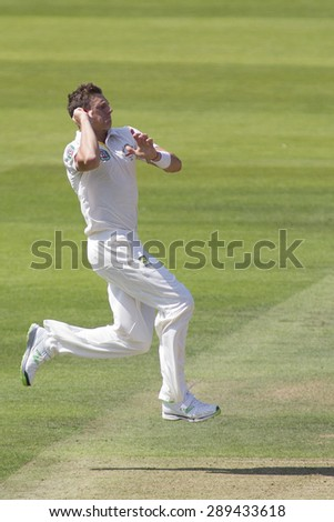 LONDON, ENGLAND - July 18 2013: James Pattinson runs in to bowl on day one of the Investec Ashes 2nd test match, at Lords Cricket Ground on July 18, 2013 in London, England.