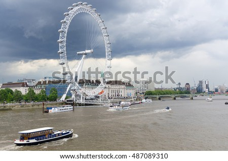 LONDON, ENGLAND - JULY 13:London Eye on the River Thames, London, England on July13, 2016. The giant ferris wheel constructed for 2000, major feature and landmark continuously turns carrying tourists