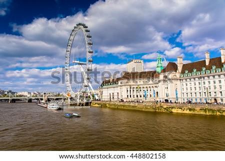 LONDON, ENGLAND - JULY 3, 2016. London Eye with beautiful blue sky. - stock photo