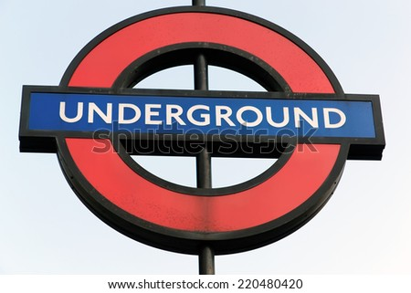 LONDON, ENGLAND - JULY 1, 2014: London Underground sign. The London Underground is the oldest underground railway in the world covering 402 km of tracks. - stock photo