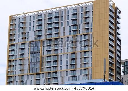 LONDON, ENGLAND - JULY 8, 2016: New apartment buildings transform the landscape of Elephant and Castle area, part of a huge regeneration program of Borough of Southwark, London, UK. - stock photo
