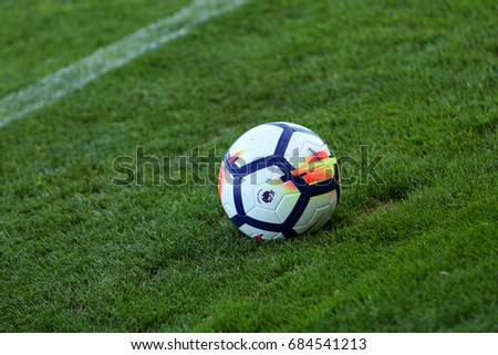 LONDON, ENGLAND - JULY 26, 2017: New Nike Ordem 5 ball. Close-up of 2017/18 season Official Premier League Ball on the green football pitch.