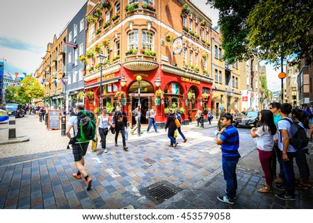 LONDON, ENGLAND - JULY 16, 2016. People walking in the street in the Covent Garden  in London, England. Covent Garden is visited by thirty million tourists each year.  - stock photo