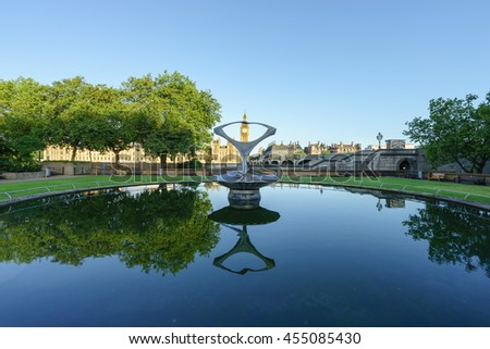 LONDON, ENGLAND - JULY 3,2016: Revolving Torsion kinetic sculpture fountain by Naum Gabo at St Thomas's Hospital, with Big Ben in the background at sunny day - stock photo