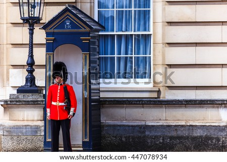 LONDON, ENGLAND- JULY 03 :2016: Sentry of the Grenadier Guards posted outside of Buckingham Palace on July in London, United Kingdom. The Grenadier Guards traces its lineage back to 1656.