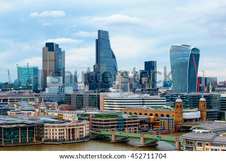 LONDON, ENGLAND - JULY 03,2016. Skyscrapers, including the recent Walkie-Talkie building and the Gherkin, rise above other towers and office buildings in the City of London. - stock photo