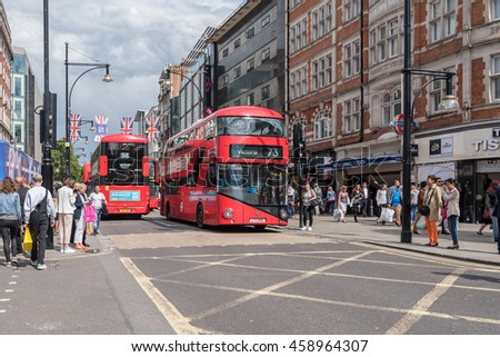 LONDON, ENGLAND - 13 JULY 2016: The london bus and shoppers along Oxford Street in London, UK