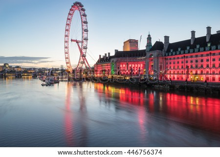 LONDON, ENGLAND - JULY 3, 2016, The London Eye on the South Bank of the River Thames before sunrise - stock photo