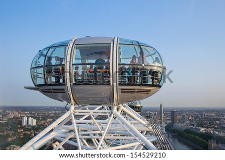 LONDON, ENGLAND - JULY 9: The London Eye, which receives over 3.5 million visitors a year on July 9, 2013 in London, England - stock photo