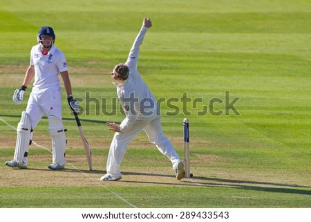 LONDON, ENGLAND - July 18 2013: Tim Bresnan watches on as Steven Smith bowls the ball on day one of the Investec Ashes 2nd test match, at Lords Cricket Ground on July 18, 2013 in London, England.