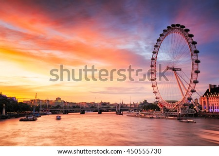 LONDON, ENGLAND - JULY 03,2016. View of City Of London at sunset with London Eye the biggest atraction in lLondon. - stock photo