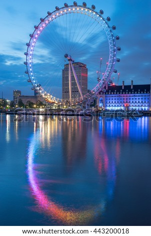 LONDON, ENGLAND - JUNE 26, 2016. London Eye before sunrise in rainbow colors at pride parade festival - stock photo