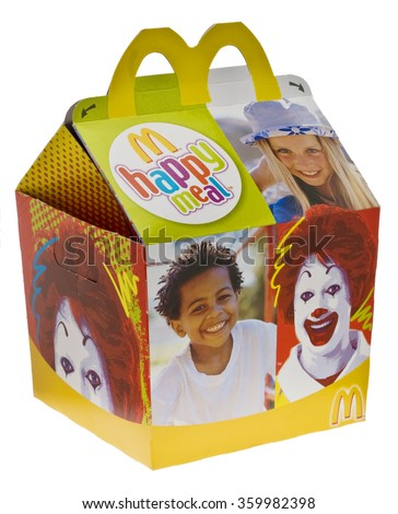 London, England - June 09, 2010: McDonald's Happy Meal for Kids to Take Away,  The Happy Meal which includes fries, burger and a toy has been sold at McDonald's since 1977. - stock photo