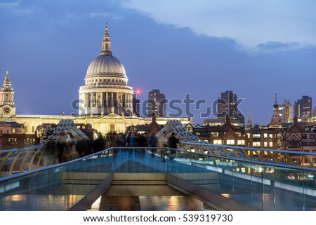 LONDON, ENGLAND - JUNE 17 2016: Night photo of Millennium Bridge and  St. Paul Cathedral, London, Great Britain