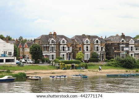LONDON, ENGLAND - JUNE 14, 2014: River Thames and town at Surrey on June 14, 2014 in London, England.  - stock photo
