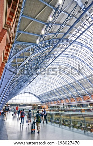 LONDON -ENGLAND JUNE 07: St Pancras Station on June 07, 2014 in London, England.St Pancras Station is the main rail terminal for Eurostar train departures from London to the European mainland. - stock photo