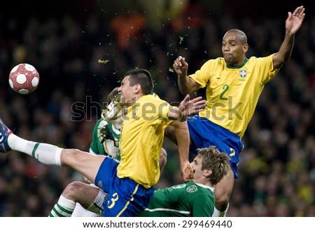 LONDON, ENGLAND. March 02 2010: Brazil's captain Lucio gets kicked in the head by Brazil's Maicon during the international football friendly between Brazil and the Republic of Ireland - stock photo