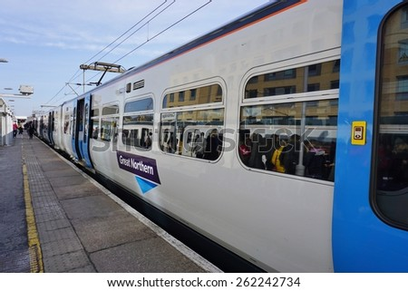 LONDON, ENGLAND -15 MARCH 2015- Editorial: Abellio Greater Anglia trains bound for Cambridge, England, depart London from the Liverpool Street station. - stock photo