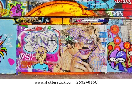 LONDON, ENGLAND -12 MARCH 2015- Editorial: On March 8, the Femme Fierce female street artist collective took over the Leake Street Graffiti Tunnel in honor of International Womens Day.