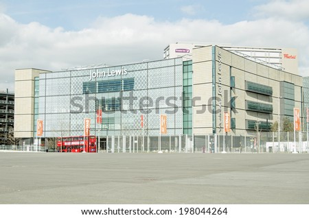 LONDON, ENGLAND - MARCH 17, 2014:  Newly-built John Lewis department store, one of the main retailers at the Westfield Shopping Centre next to London's Olympic Park in Stratford. - stock photo