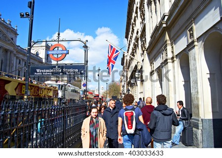 London, England - March 25th 2016: People walking near the station of Westminster in London, England