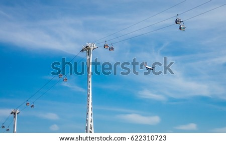 London, England -  25 March 2017 : The Emirates Air Line across river Thames in London, UK
