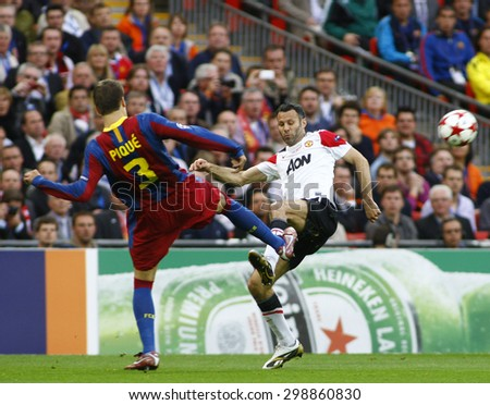 LONDON, ENGLAND. May 28 2011: Barcelona's defender Gerard Pique and Manchester's midfielder Ryan Giggs during the 2011UEFA Champions League final between Manchester United and FC Barcelona - stock photo