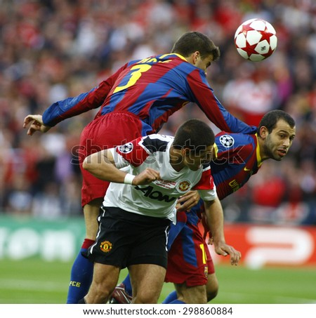 LONDON, ENGLAND. May 28 2011: Barcelona's Gerard Pique,  Javier Mascherano and Javier Hernndez during the 2011UEFA Champions League final between Manchester United and FC Barcelona, at Wembley Stadium - stock photo