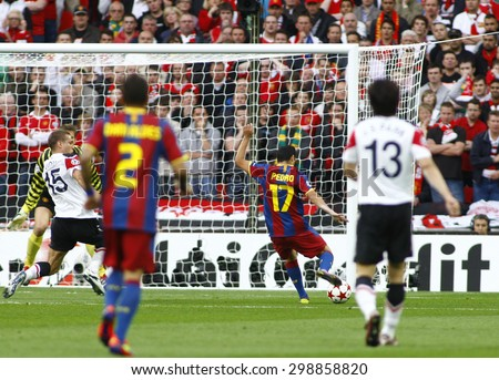 LONDON, ENGLAND. May 28 2011: Barcelona's midfielder Pedro Rodr�¢??guez takes a shot at goal during the 2011UEFA Champions League final between Manchester United and FC Barcelona, at Wembley Stadium - stock photo