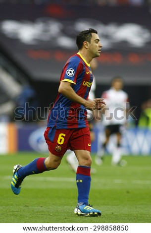 LONDON, ENGLAND. May 28 2011: Barcelona's midfielder Xavi Hernandez  during the 2011UEFA Champions League final between Manchester United and FC Barcelona, at Wembley Stadium - stock photo