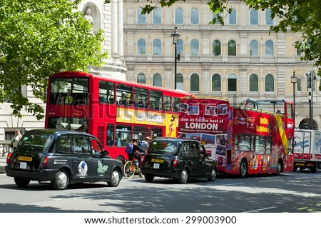 LONDON, ENGLAND - MAY 30:  London double-decker buses and black taxi cabs in the city center on May 30, 2015 in London - stock photo