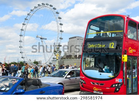 LONDON, ENGLAND - MAY 30:  London Eye and double-decker bus in the city center on May 30, 2015 in London - stock photo