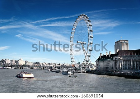 LONDON, ENGLAND - MAY 2: London Eye on May 2 2013 in London. The 135 meter landmark is a giant Ferris wheel situated on the banks of the River Thames in London, England