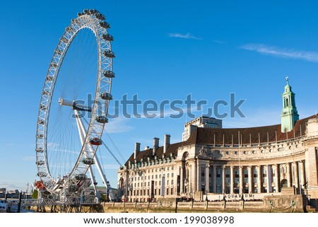 London, England - May 25, 2014:London's famous ferris wheel called the London Eye and Aquarium. - stock photo