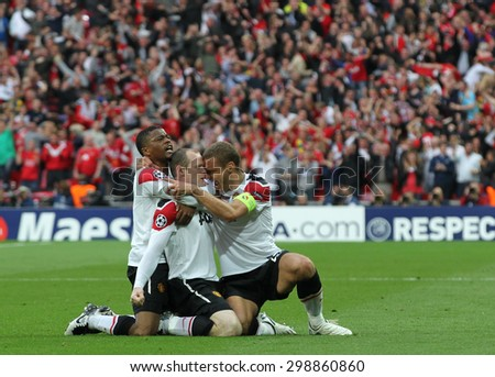 LONDON, ENGLAND. May 28 2011: Manchester's defender Patrice Evra Manchester's forward Wayne Rooney and Manchester's defender Nemanja Vidic (captain) during the 2011UEFA Champions League final - stock photo