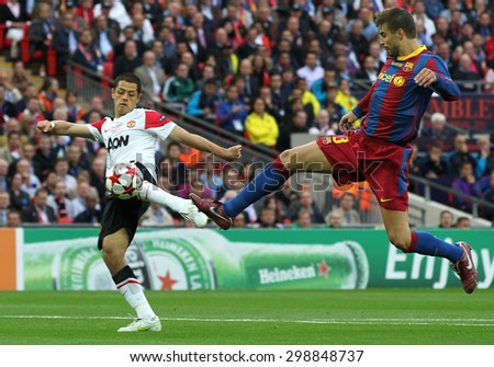 LONDON, ENGLAND. May 28 2011: Manchester's forward Javier Hernandez and Barcelona's defender Gerard Piquet during the 2011UEFA Champions League final between Manchester United and FC Barcelona
