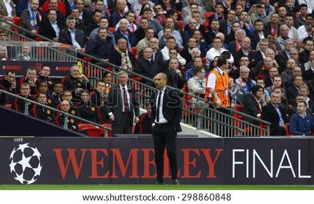 LONDON, ENGLAND. May 28 2011: Manchester's manager Sir Alex Ferguson and Barcelona's manager Josep Guardiola during the 2011UEFA Champions League final between Manchester United and FC Barcelona - stock photo