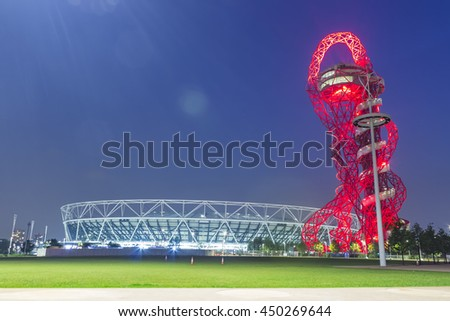 London, England - May 27, 2016: Night view of the illuminated Olympic stadium and ArcelorMittal Orbit observation tower in the Olympic Park of London, England.