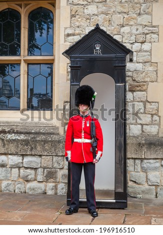 LONDON, ENGLAND MAY 31st: Guard stands guard outside tower of london crown jewels exhsibit on 31st May 2014 in London England.