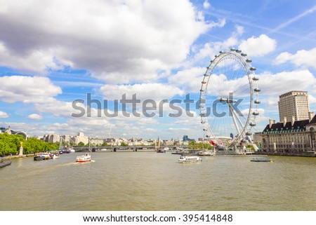 LONDON, ENGLAND - MAY 12, 2011: The London Eye and the Thames river in London. The entire structure of the London Eye is 135 metres tall and the wheel has a diameter of 120 metres.