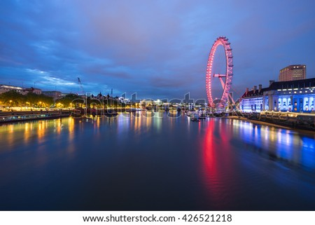 LONDON, ENGLAND - May 19, 2016 : The London Eye near the River Thames in London at dusk, England. The London Eye is a giant Ferris wheel on the South Bank of the River Thames in London - stock photo
