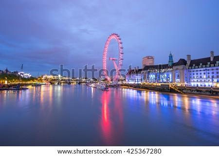 LONDON, ENGLAND - MAY 19, 2016, The London Eye on the South Bank of the River Thames at night in London, England