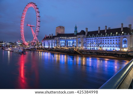 LONDON, ENGLAND - MAY 19, 2016, The London Eye on the South Bank of the River Thames at night in London, England - stock photo