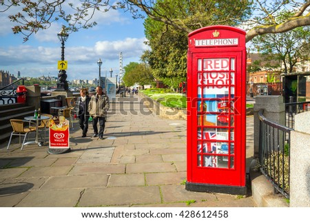 LONDON, ENGLAND - May 14, 2016 : Traditional red phone boths on the street of London, England. London is the capital and most populous city of England, Britain, and the United Kingdom. - stock photo