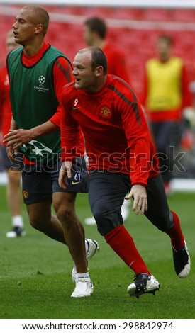 LONDON, ENGLAND. May 27 2011:  Wes Brown and Wayne Rooney during the official training session for the 2011UEFA Champions League final between Manchester United and FC Barcelona, at Wembley Stadium - stock photo