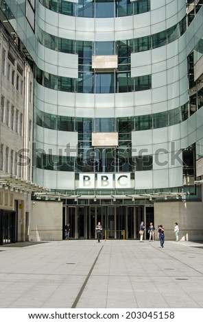 LONDON, ENGLAND - MAY 18, 2014: Workers at piazza and entrance to  BBC New Broadcasting House in London.  The building houses journalists and programme makers together with broadcasting studios. - stock photo
