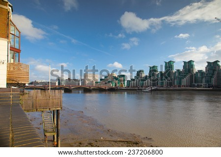 London,England-November 18,2011: Early autumn evening view of Canary Wharf London.Canary Wharf is a major business district located in Tower Hamlets. - stock photo