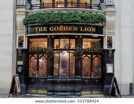 London, England - November.21.2016 - Golden Lion- small, ornate bay-fronted corner pub rebuilt in 1899/1900, with attractive tiles over the main bar, facing Christie's auction rooms